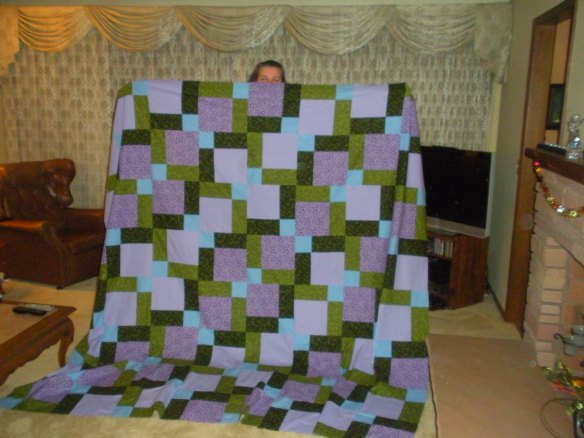 Me, peeking over the quilt top