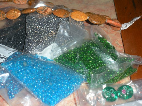More vintage Italian seed beads, plus a strand of flat oval Jasper beads and 2 sweet lampwork beads that will become earrings