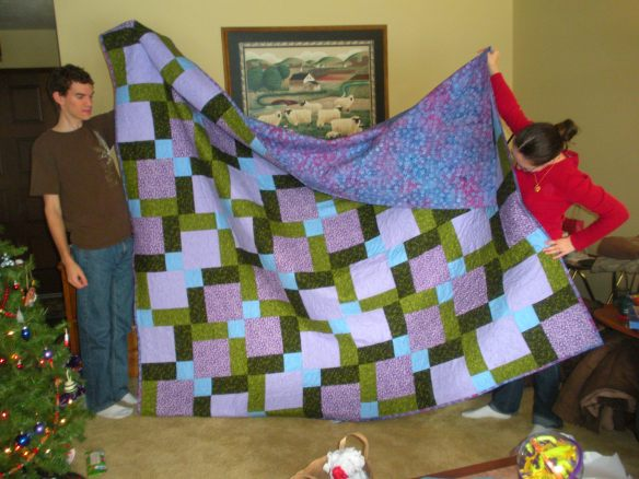 FINISHED PROJECT last December:   The Lovebirds with their new quilt (top folded over so you can see the back)