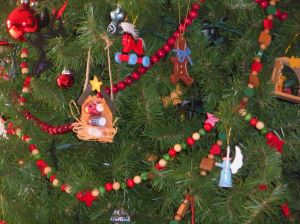 decorated by boys (note the angel facing the tree)
