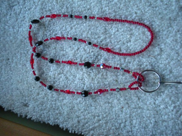 Red and black lanyard  with 8mm round black Jaspar beads, Jet lentil-shaped beads,and Vintage Venetian red glass seed beads