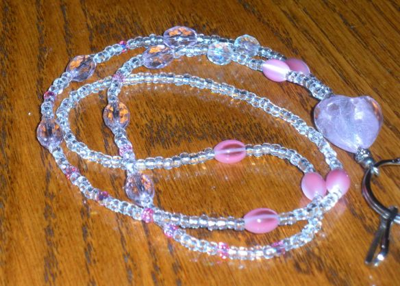 Lanyard with pink foil-lined heart, pink Swarovski crystals, clear Vintage Venetian glass seed beads, pink glass Czech beads and  pink fiber optic beads.
