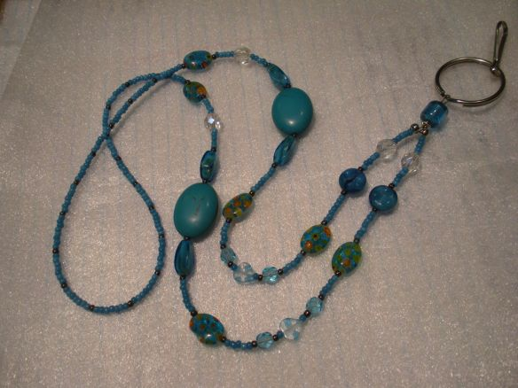 "Turquoise-coloured Lanyard made with Vintage Venetian seed beads, Millefiori beads, and ""fire-polished"" Czech beads"