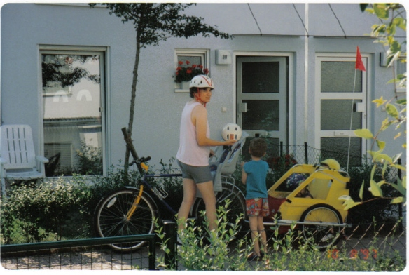 My neighbor took this picture from her porch as I prepared to haul 100-pounds worth of children on a bike ride along the local farmland. (Summer, 1997)