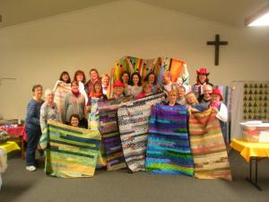 "2012 Creativity Retreat women & ""jelly roll race"" quilts"