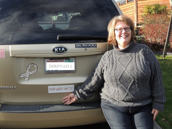 Mrs. G. shows off my car magnet (license plate is only wishful thinking on my part)