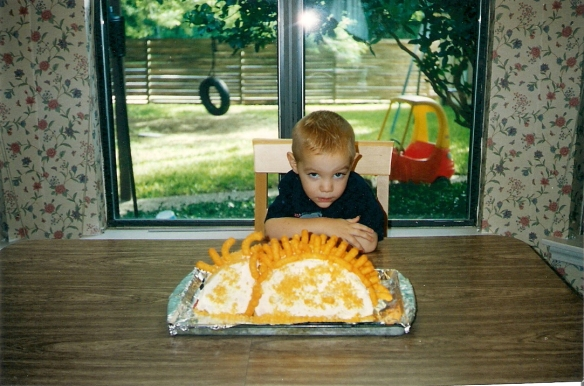 Age three, SM wanted a dinosaur cake. His parents made one with Cheetos... His first (but not last!) Cheesy-Puffasaurus birthday cake