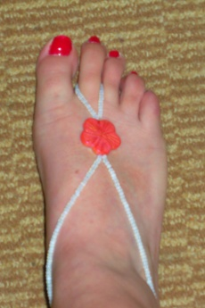 Barefoot sandal in opal with coral hibiscus bead