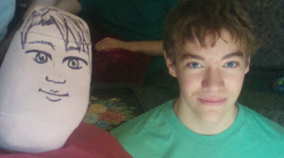 TWINS artwork on cast by DIL, teen minus glasses as model