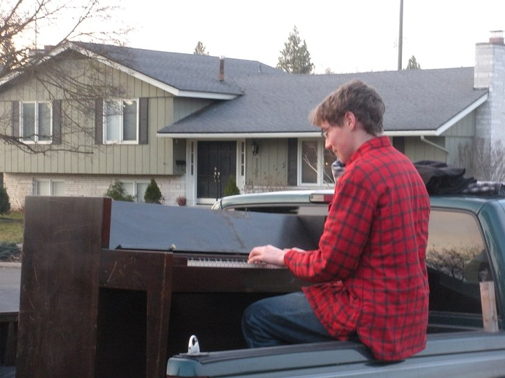 DSCN2366  playing piano on back of truck, websized