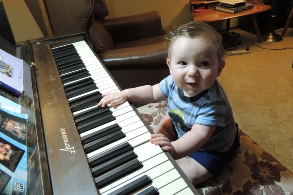 His daddy had just finished playing so we gave Little Foot a turn at tickling the ivories.