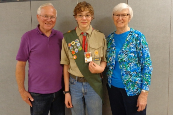 An older picture of The Scout and his grandparents. He's at least 3 inches taller now.